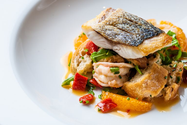 Sea bass and tiger prawn panzanella-style salad with chilli dressing