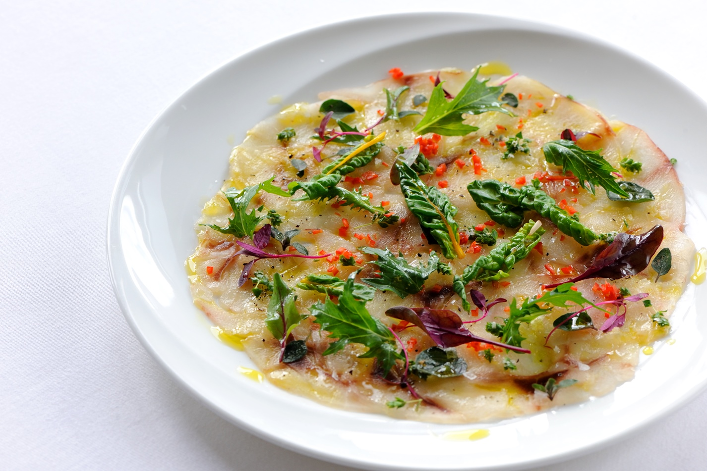 Sea bass carpaccio with chilli, oregano and olive oil