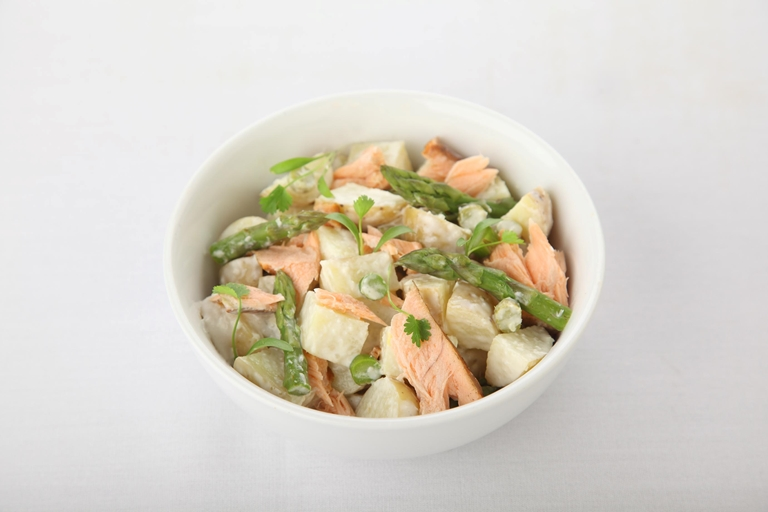 Hot smoked salmon potato salad with asparagus and horseradish dressing