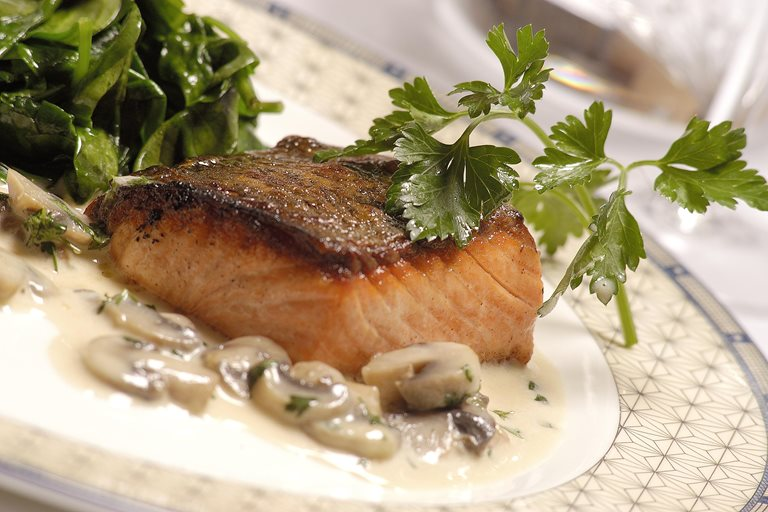 Pan-fried salmon with mushroom sauce