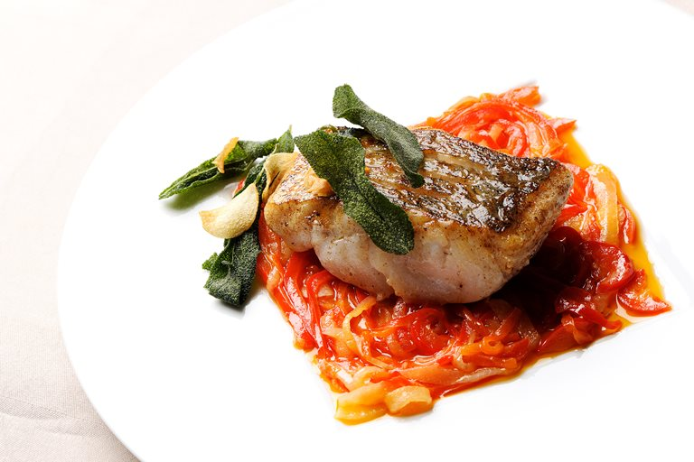 Pan-fried hake with red pepper relish