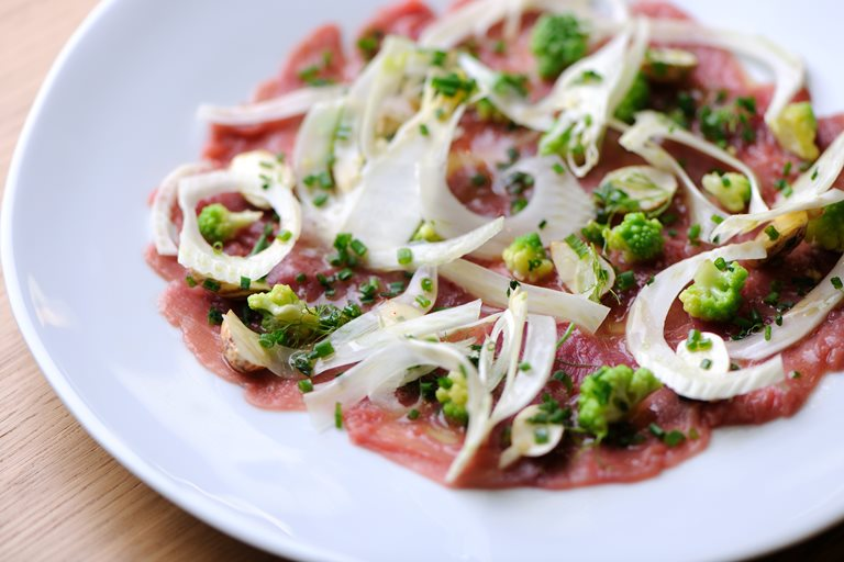 Duck carpaccio with romanesco, cauliflower, fennel and hazelnuts