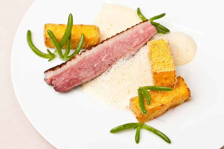 Duck breast with aromatic polenta fries and orange vinaigrette