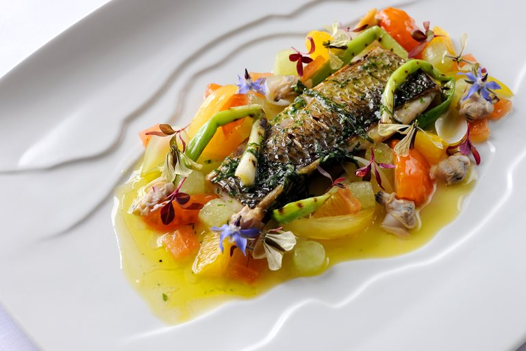 Fillet of silver mullet with grilled spring onions, cucumber, confit tomatoes and sauce vierge