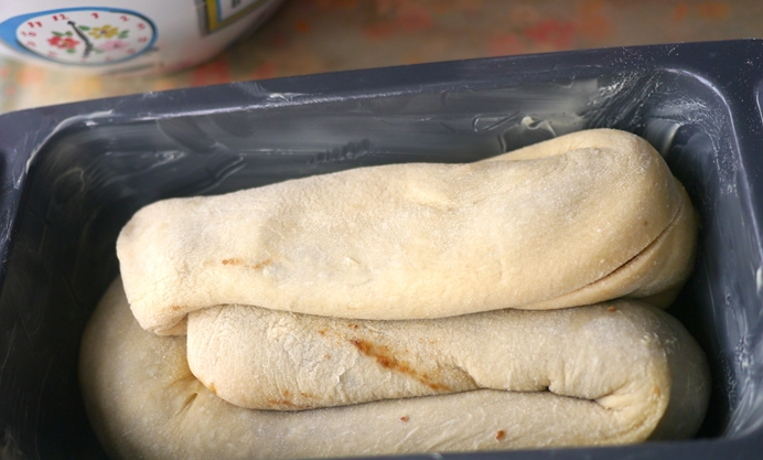 Coil the tails of dough in on themselves, tucking the ends in