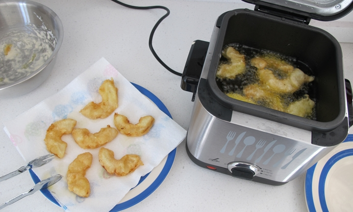 Coat the pineapple in the batter and fry in the oil until golden brown