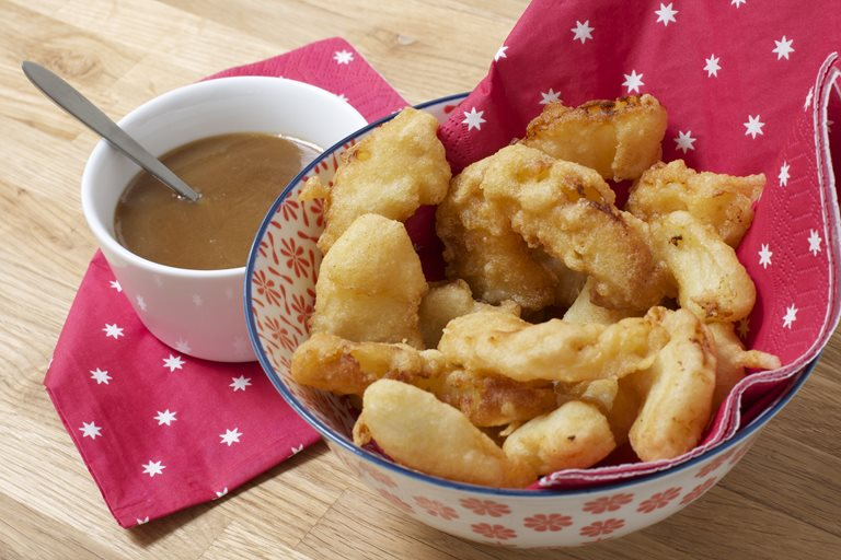 Pineapple fritters with five spice toffee dipping sauce