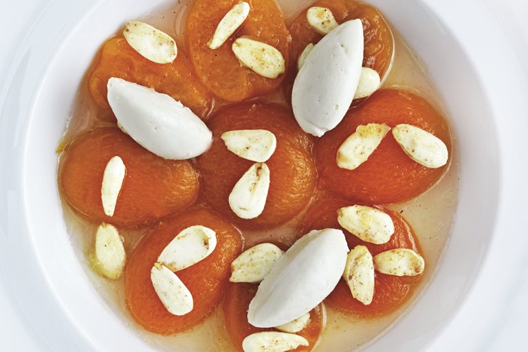 Poached apricots with honey ice cream and fresh almonds
