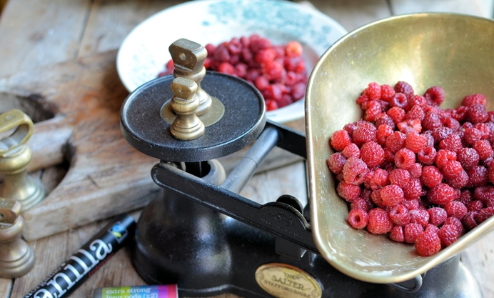 Place the raspberries in a large pan