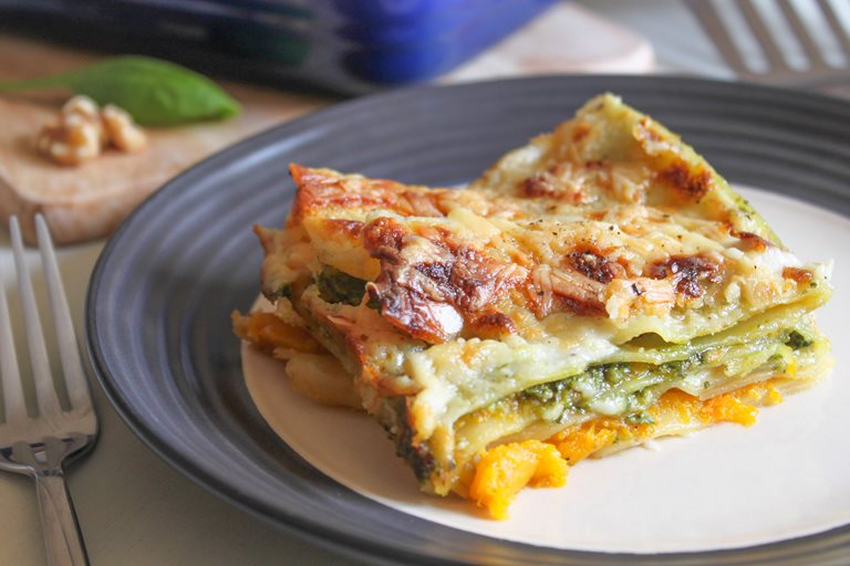 Cheesy roasted squash lasagne with spinach and walnut pesto