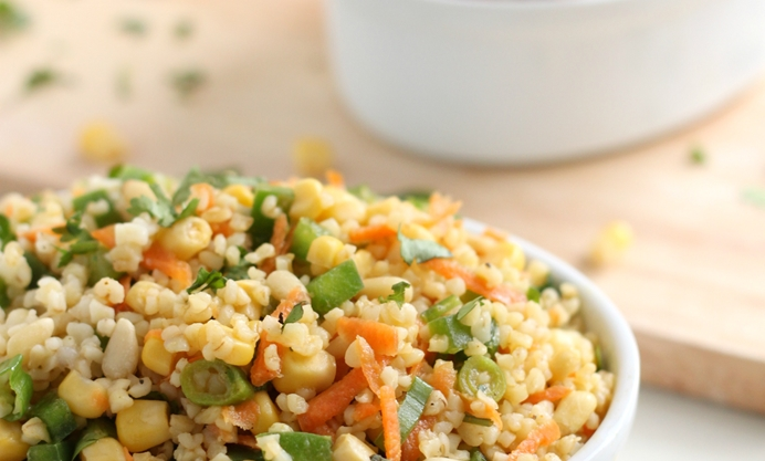 When the bulgur wheat is cooked, add the dressing and all other ingredients.