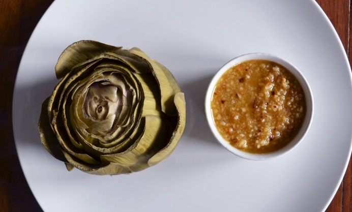 Serve the artichoke whole with a side of hazelnut butter
