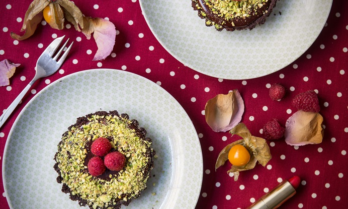 Decorate with chopped pistachios and raspberries
