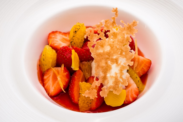 Strawberry and orange soup with citrus cream and puff pastry crisp