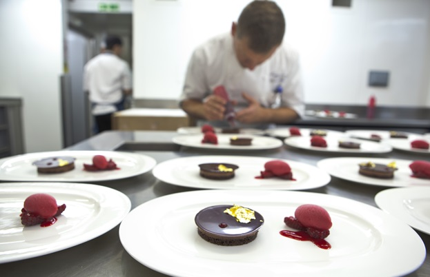 Pastry chef Benoit Blin puts the finishing touches on his Manjari chocolate and raspberry crumble
