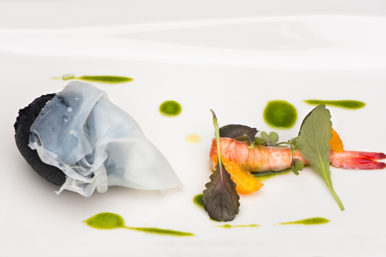 Fried puff of squid ink stuffed with burrata, raw prawn, mandarin and tarragon oil
