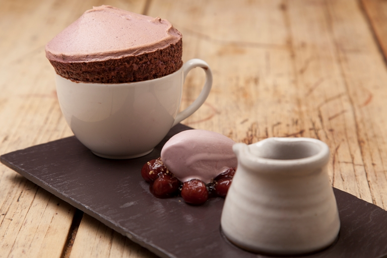 Black cherry soufflé with its own ice cream, hot chocolate
