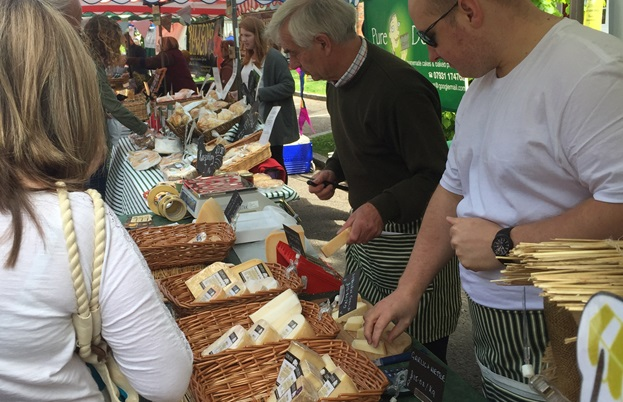 People browsing for cheese at Winchester Farmer's Market