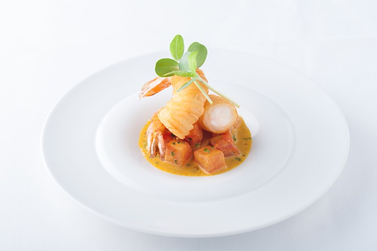 Compressed watermelon and king prawn curry