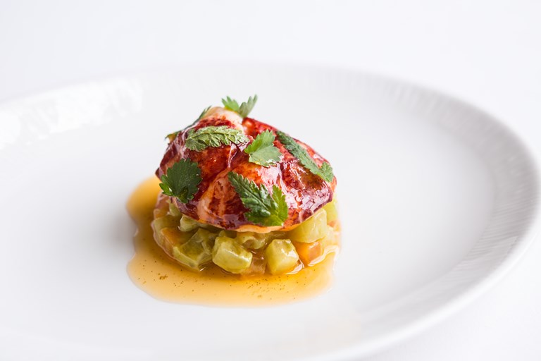 Lobster in vanilla butter with heirloom tomatoes and avocado