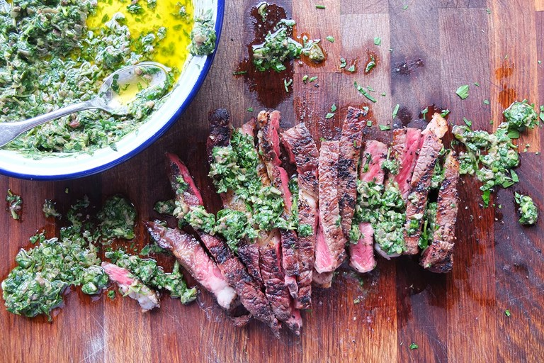 Barbecue rib eye steak with watercress salsa verde