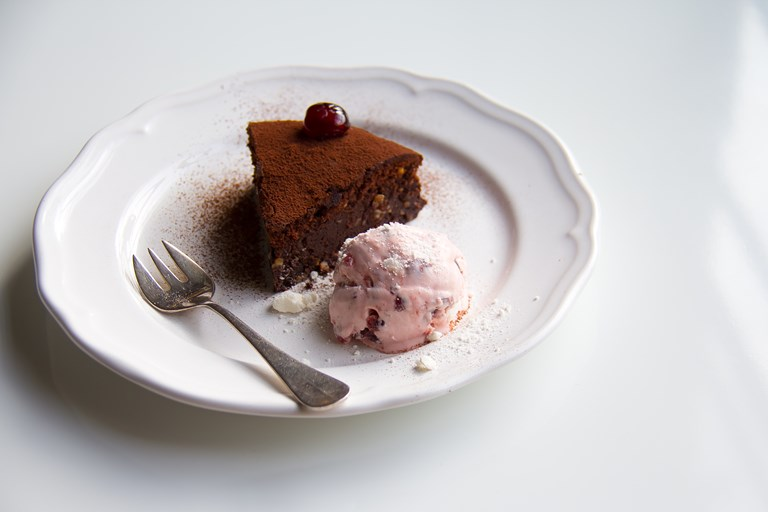 Chocolate nut torte with cherry meringue ice cream