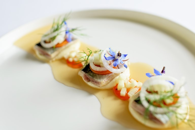 Pickled herring with parsnip cream, white radish and apple dashi