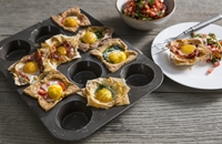 Egg cups with a spicy tomato salsa