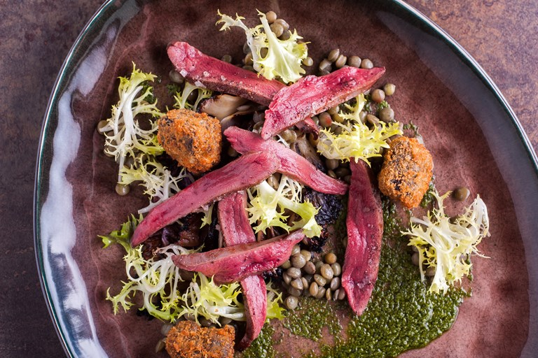 Wood pigeon breast with salsa verde and black pudding beignets