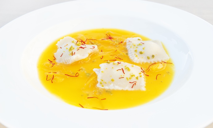 Almond ravioli filled with cassata on top of orange soup