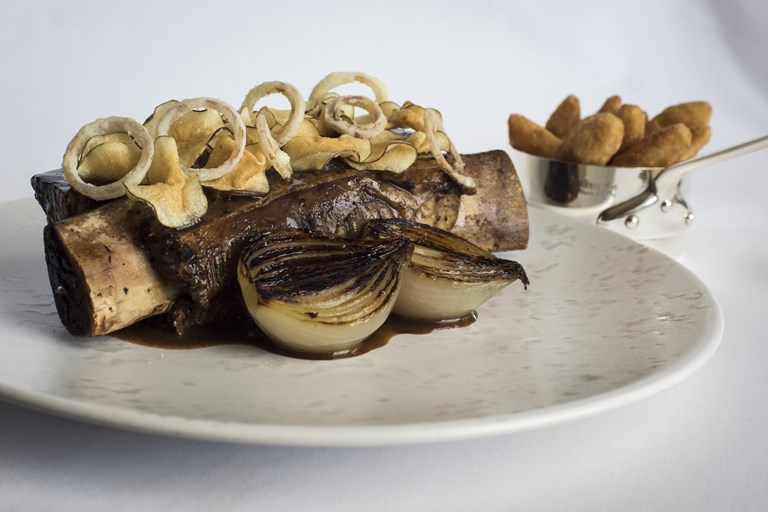 Slow cooked jacob's ladder, jerusalem artichoke chips, roscoff onions