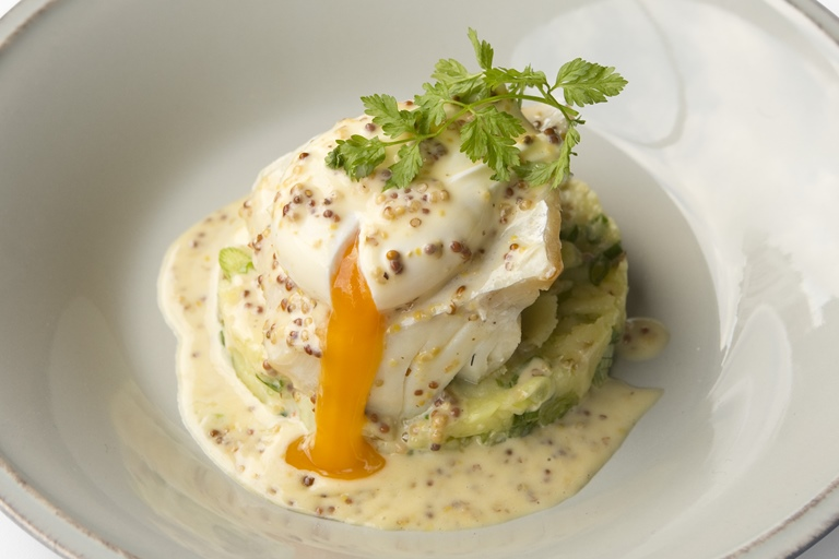 Smoked haddock with crushed potatoes and poached egg