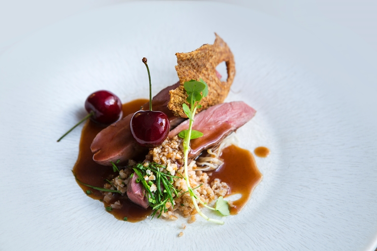 Duck breast with celeriac choucroute, bulgar wheat and cherries