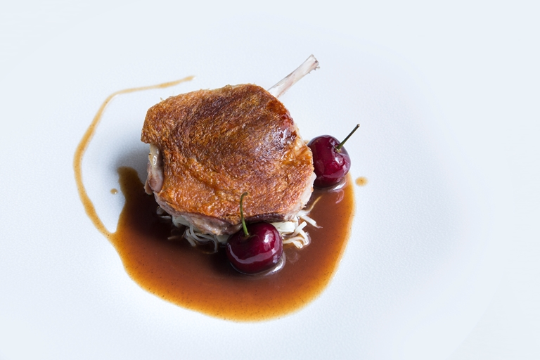Duck leg with celeriac choucroute, bulgar wheat and cherries