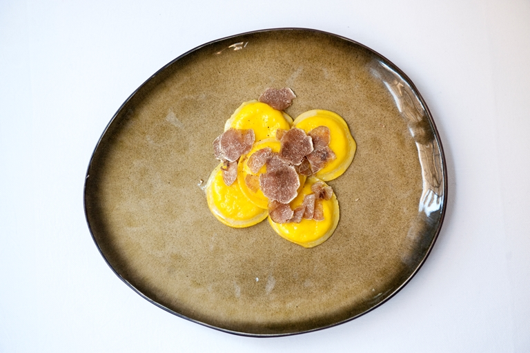 Egg yolk ravioli with truffle and Parmesan