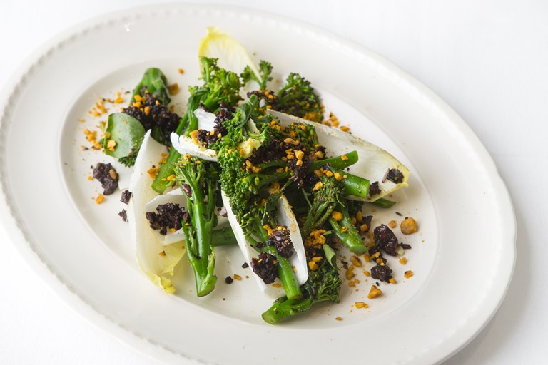 Tenderstem broccoli with black garlic, poppy seeds and olive dressing