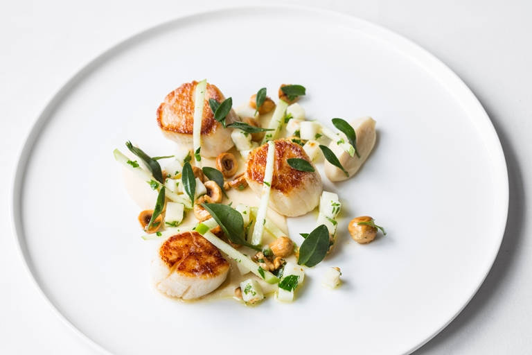 Scallops with baked and puréed celeriac, apple and hazelnuts