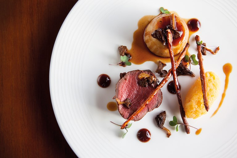 Sika deer with mashed swede, chanterelles and twiglets