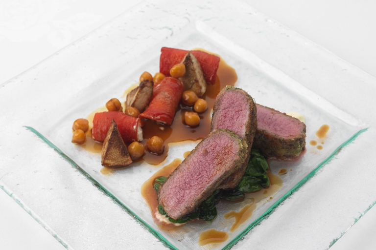 Herb crusted loin of lamb with chickpeas, confit tomato, artichoke and goat's cheese