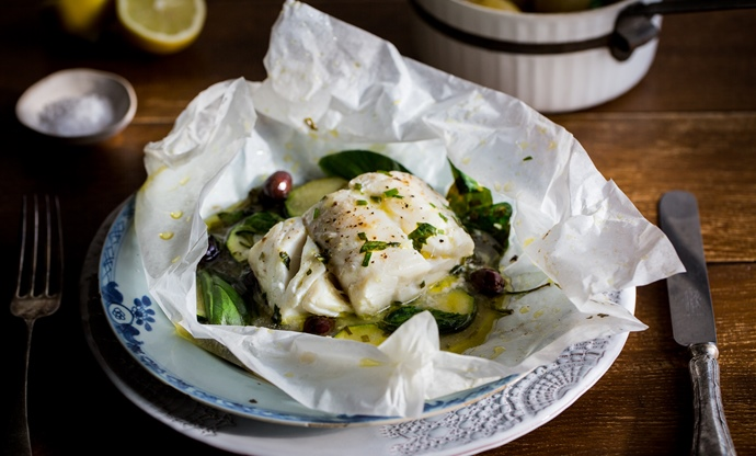 Skrei cod en papillote with olives, spinach and herbs