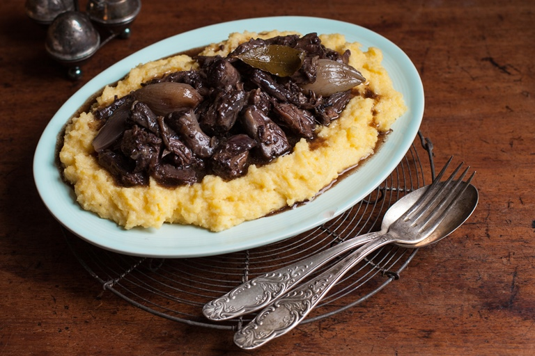 Slow-cooked oxtail stew in red wine on a base of polenta