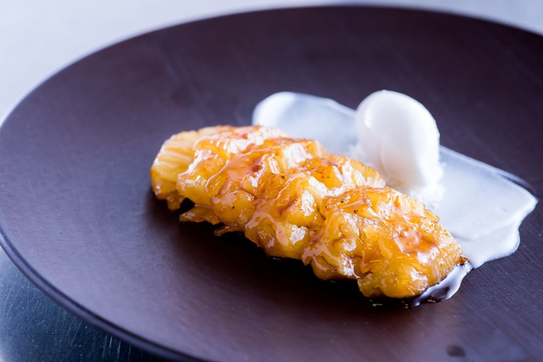 Rum-poached pineapple with coconut lime sorbet