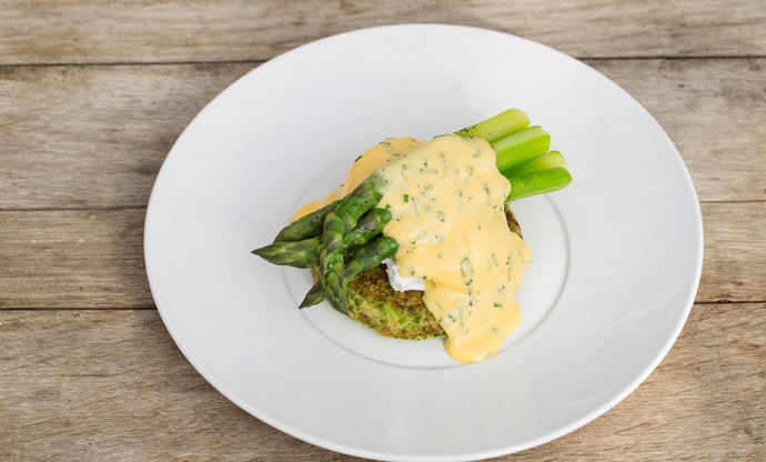 Organic pea pancake, asparagus and poached eggs with a herb sabayon