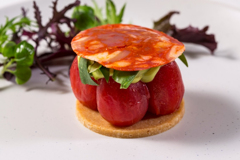 Plum tomato tart with Parmesan pastry, avocado and chorizo