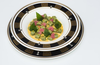 Nettle gnocchi with fois gras cream and grape caviar