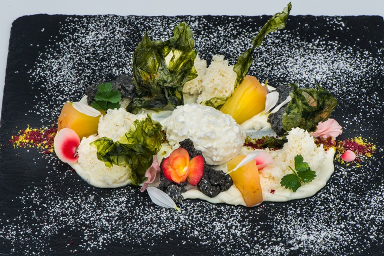 The yoghurt meets the sea – rosemary and yoghurt ice cream with yoghurt sponge, pineapple and caramelised seaweed