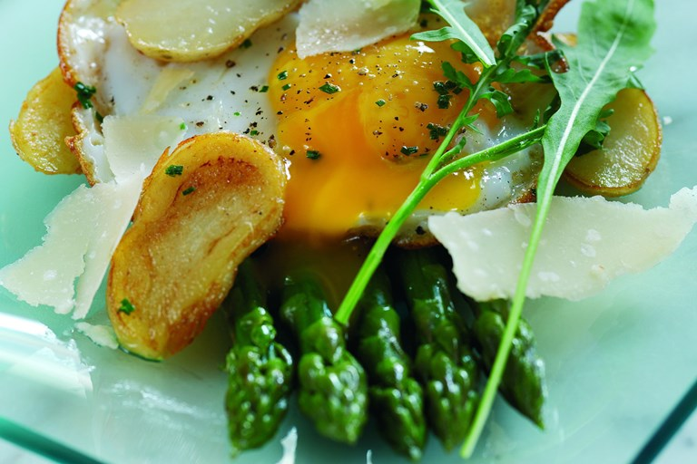 Sauté of Jersey Royals with fried duck egg and griddled asparagus and Parmesan salad
