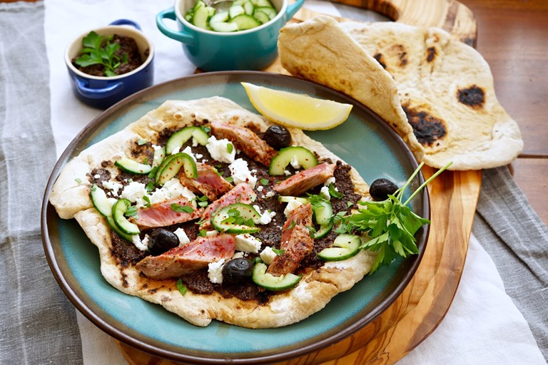 Lamb flatbreads with olive tapenade, feta and quick-pickled cucumber