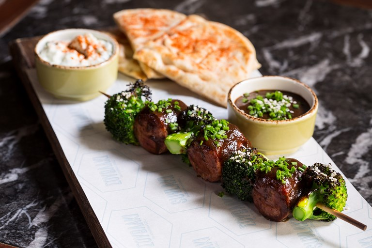 Wild boar souvlaki with sticky prune glaze