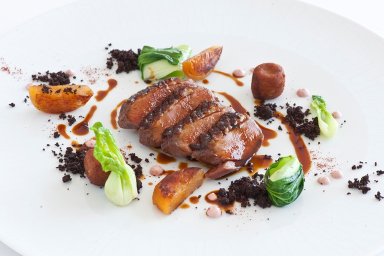 Tandoori duck breast with duck croquettes, apricots and pak choi
